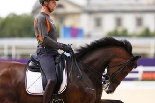 Netherlands rider Patrick van der Meer riding Uzzo in an unsightly rollkur moment during the pair's dressage warm-up.