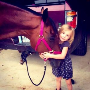 Child Hugs Recipient Mare that almost went to Slaughter