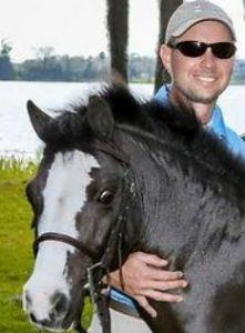 Officials confirm Scott Langton's death was suicide. The former equine veterinarian is seen during happier times.