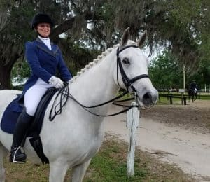 Kim Long is a full-time nurse. She completed her USDF Bronze and Silver medals aboard her pony gelding Micah.