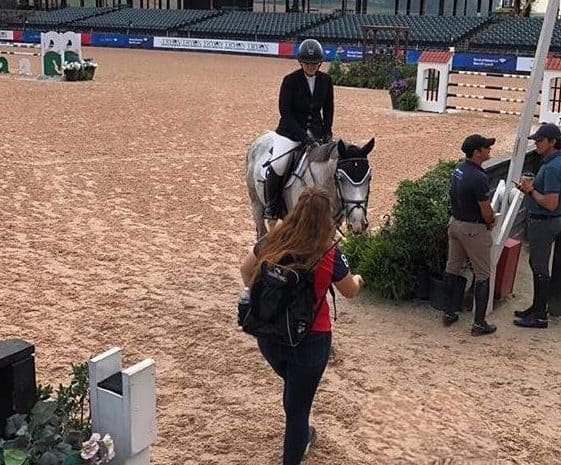 Olivia gives Lenny a peppermint after a successful jumper round